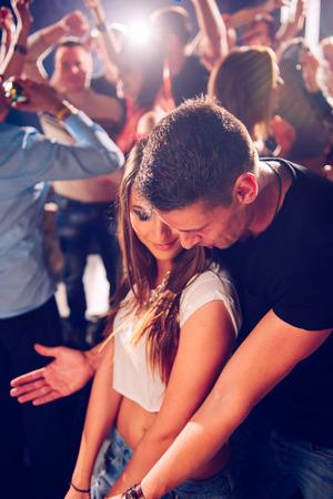 Couple flirting in club
