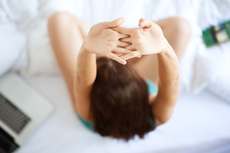 Stretching in bed Stock Photo