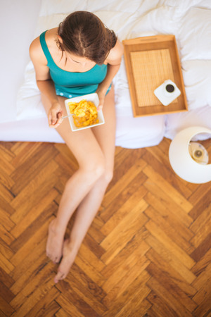Eating breakfast in bed Imagens