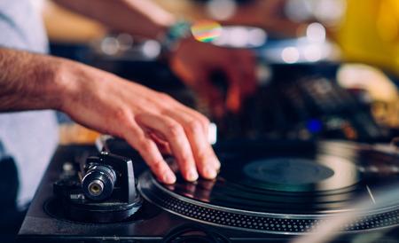 DJs hands on turntable