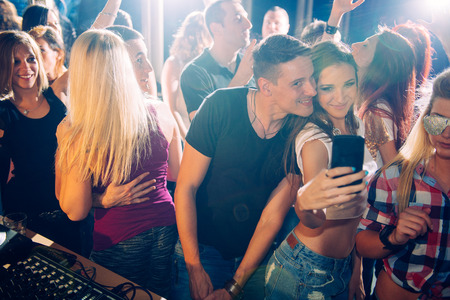 Party people taking selfie Imagens - 29983911
