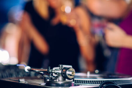 Party people in front of turntable