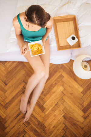 Eating breakfast in bed Stock Photo