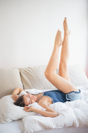 Stretching in bed Imagens