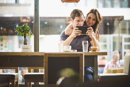 happy young couple: Young couple looking tablet Stock Photo