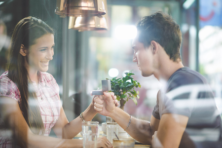 Engagement ring in cafe Imagens