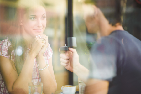 propose: Engagement ring in cafe Stock Photo