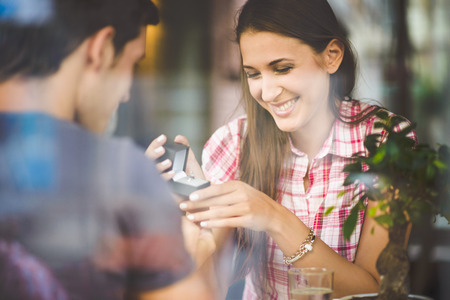 marriage: Engagement ring in cafe Stock Photo