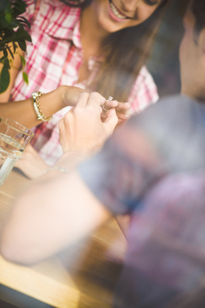 Engagement ring in cafe Stock Photo