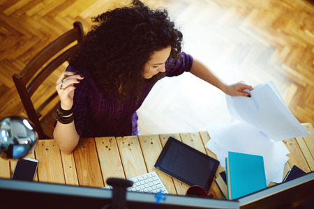 Woman working at home Stock Photo