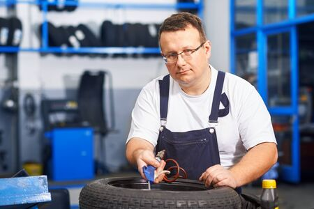 shop skill: Mechanic in car service Stock Photo