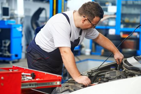 Mechanic in car service Imagens