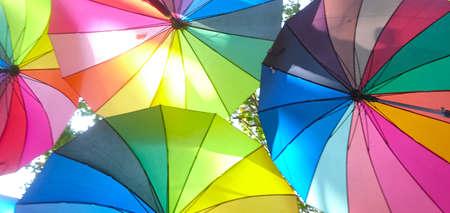 Bright colored umbrellas in the sky.