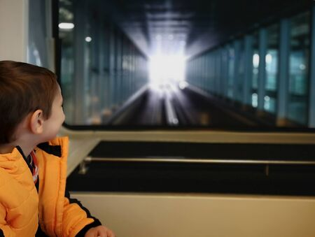 Little boy rides a train between terminals at Frankfurt am Main airport,Germany