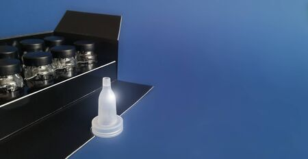 Removable dropper in front of bottles in black box on classic blue background Imagens