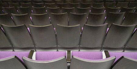 Empty rows of seats in hall.Concept of corona quarantine,cancel of mass events 版權商用圖片