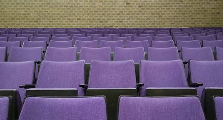 Empty rows of seats in hall.Concept of corona quarantine,cancel of mass events