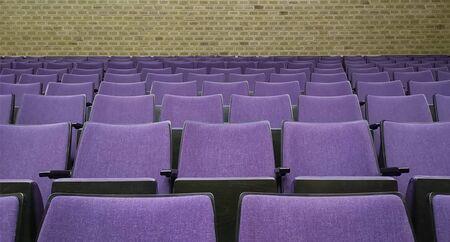 Empty rows of seats in hall.Concept of corona quarantine,cancel of mass events Фото со стока