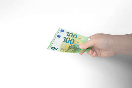 Closeup of outstretched hand holding two hundred Euro bills isolated on white background.Concept of giving money,making donation,currency exchange,buying something,putting on deposit,saving,Copy space