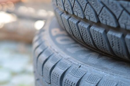 close shot of black car tyres as car service advertisement