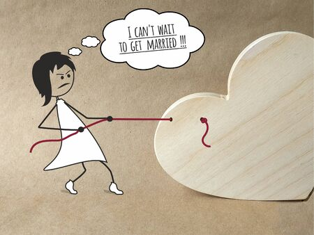 Wooden heart and hand-drawn woman on a beige background. A woman wants to marry against the will of a man. A woman pulls a man's heart by a rope, wishing a wedding. Phrase: I can't wait to get married Banco de Imagens
