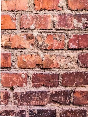 Pattern with the texture of an old brick wall. Red brick background with cement. Grunge texture for website or text.