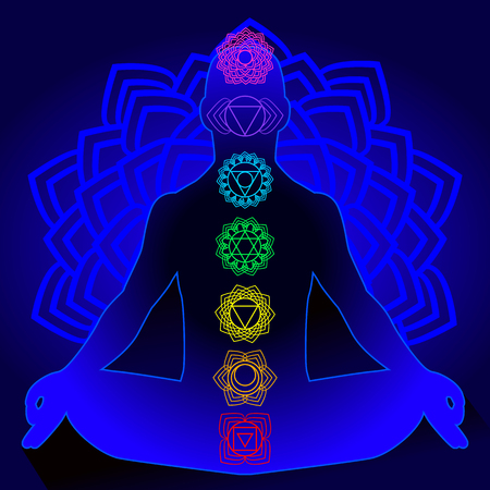 Silhouette of man with symbols of chakra