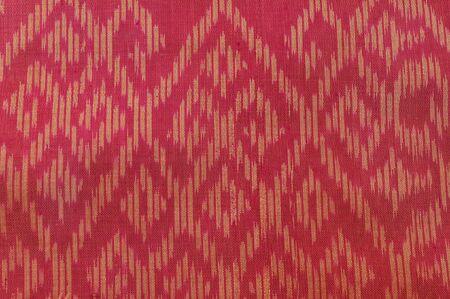 Thai red silk pattern photo