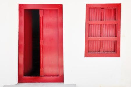 thai red door open and window Stock Photo