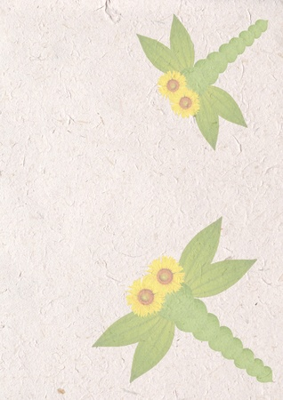 dragonfly by green leaves and sunflower on recycle paper craft , ecology concept with animal sign on recycle paper  Stock Photo - 10845532