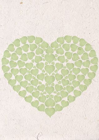 green heart on recycle paper craft with green leaf, ecology concept with heart of green leaves recycle paper