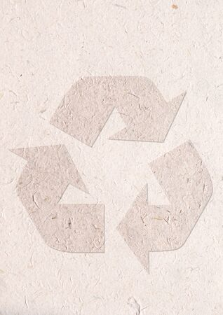 recycle paper craft, ecology concept with in recycle sign on recycle paper photo