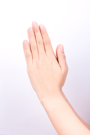 wishful: finger hand symbols isolated concept Wai is the traditional Thai greeting on white background