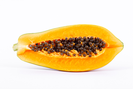 excretion: Ripe papaya is healthy fruit and  high nutritional value on the white background isolated