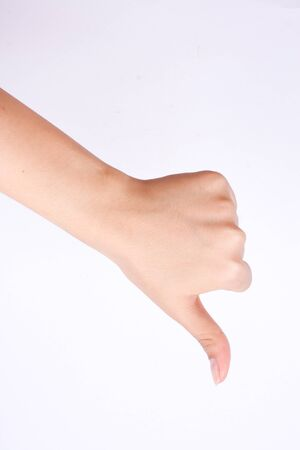 no mistake: finger hand symbols isolated the concept hand showing thumbs down and bad dislike button on white background Stock Photo