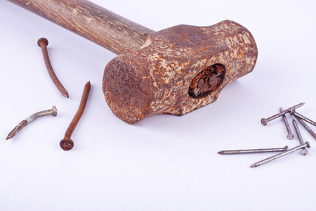rusty nail: old Sledge hammer and rust nail tack used on white background tool isolated Stock Photo