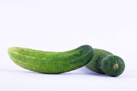 cucumis sativus: couple fresh green cucumber on white background healthy vegetable food isolated