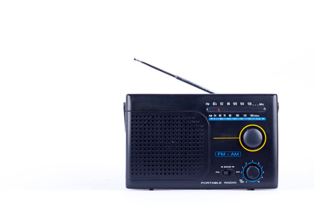 am radio: old black vintage retro style AM, FM portable radio transistor receiver on white background  isolated