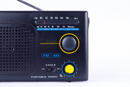 fm: AM, FM portable radio transistor receiver of black vintage retro style   on white background  isolated  close up
