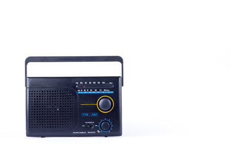 fm: black vintage retro style AM, FM portable radio transistor receiver on white background  isolated