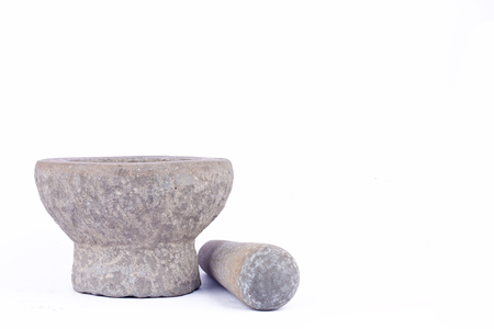 masticate: Old used granite stone mortar and pestle are Thai cooking tool on white background food isolated Stock Photo