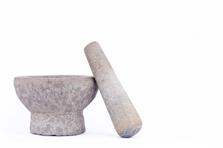 masticate: granite stone mortar and pestle are Thai cooking tool on white background food isolated Stock Photo