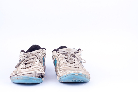 worn out: Old blue worn out futsal sports shoes  on white background  isolated