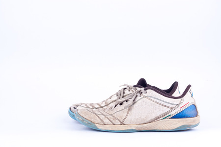 worn out: Old worn out futsal sports shoes  on white background  isolated
