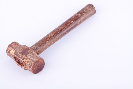 old Sledge hammer used rust  on white background tool isolated