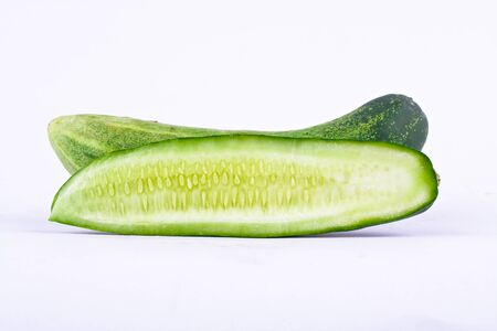 cucumis sativus: fresh cucumber and slice of cucumber on white background healthy vegetable food isolated Stock Photo