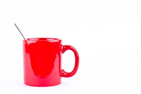red coffee or tea cup and spoon on break time in white background drink isolated