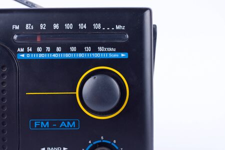 fm: old black vintage retro style AM, FM portable radio transistor receiver on white background isolated close up