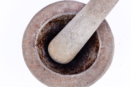 masticate: old granite stone mortar and pestle are Thai cooking tool on white background food isolated ( top view )