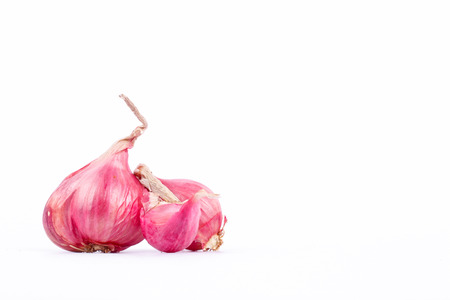 Shallots or red onion is a popular ingredients in cooking on the white background food isolated.